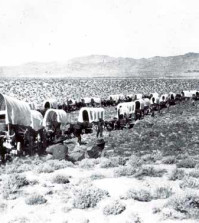 A wagon train crossing the West in the 1800s. Photo Library of Congress.