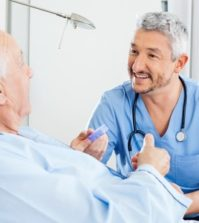 39002281 - happy caretaker discussing prescription with senior man