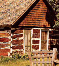 Sam Deon's cabin, built in 1858, still stands just south of the LaPorte post office. Photo by Bill Lambdin years ago.